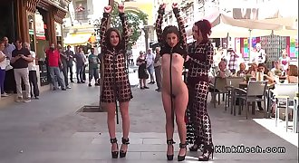 Slaves in see thru dresses in public
