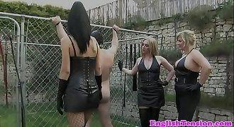 Female dom take turn whipping obedient outdoor