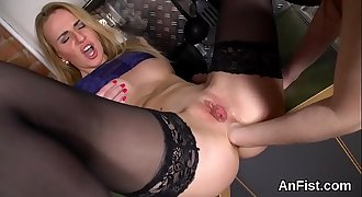 Hot lesbian peaches are widely opened and fist fucking ass holes