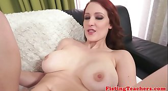 Redhead lesbo fisted while standing up